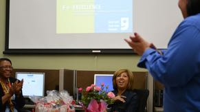 Volunteer Paola Stone congratulates graduates of Intel © Easy Steps computer skills course. The training was offered through a collaboration with Fresh Start Women's Foundation and Goodwill Career Center in Chandler.