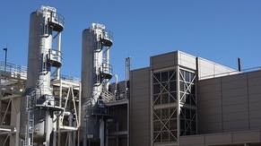 West side of Central Utility Building (CUB) with view of gas towers and ultrapure water (UPW) tanks.