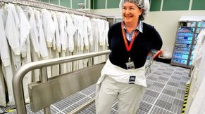 """Fabrication facility (fab) employees wear special suits, nicknamed """"bunny suits,"""" which are designed to keep contaminants, like lint and hair, off of wafers during chip manufacturing."""
